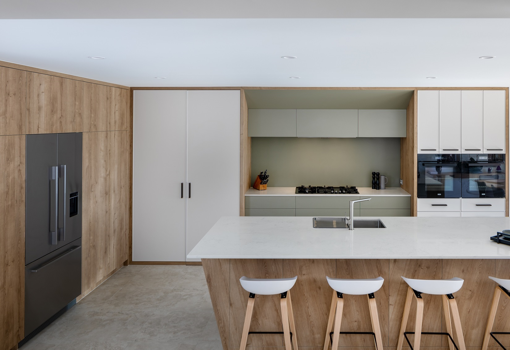 Kitchen using earthy tones with island bench