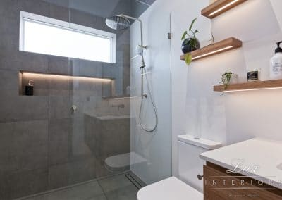 Wide shot of bathroom and shower