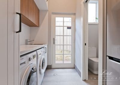Laundry, fridge recess and powder room