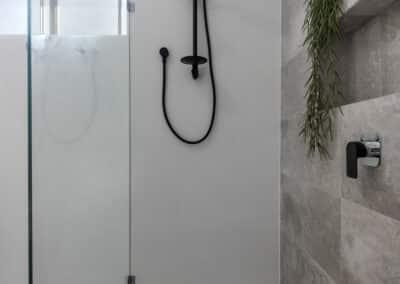 shower internal shot with black tapware