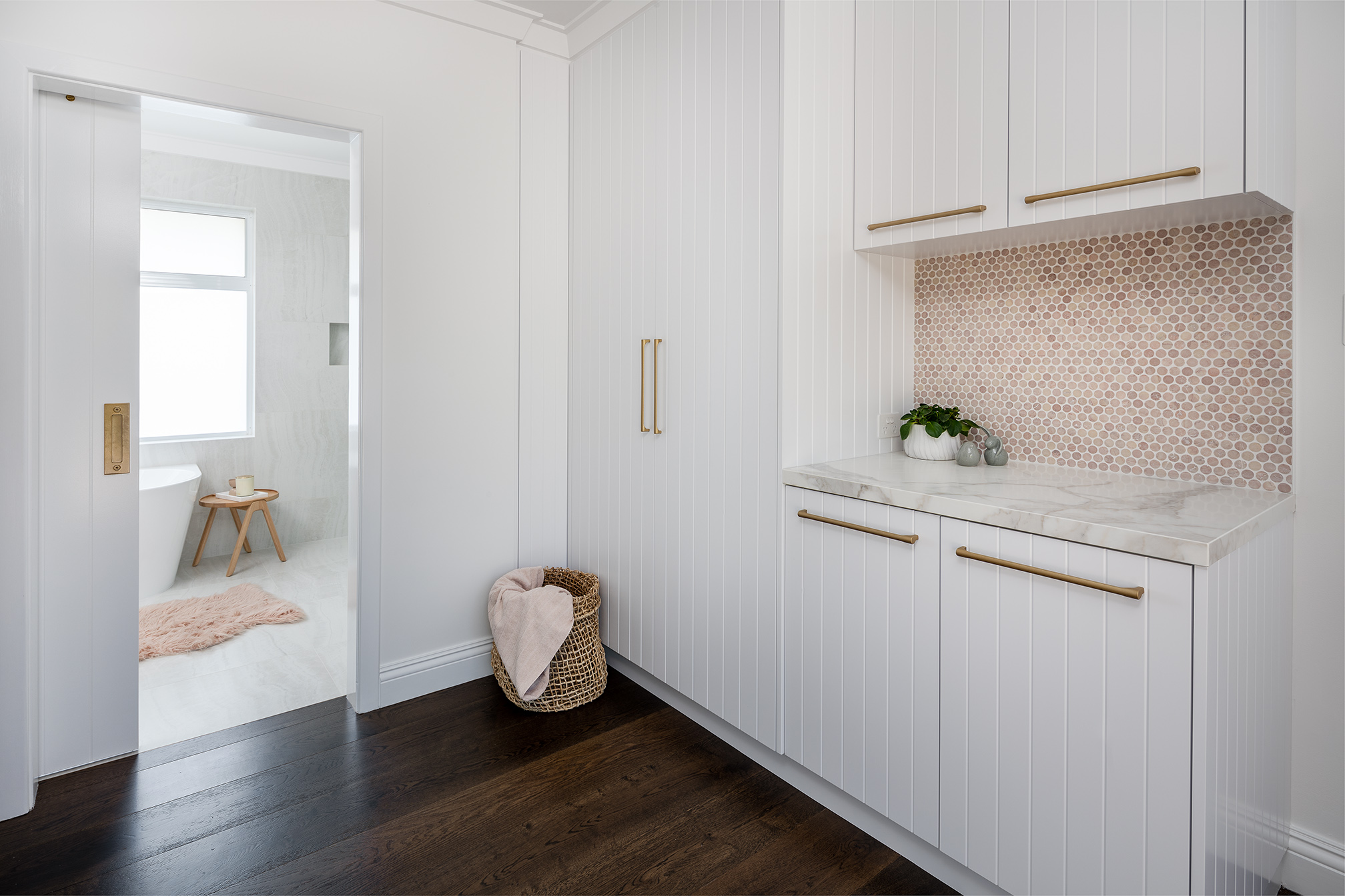 North Beach Coastal Barn Laundry with floor to ceiling cabinetry and bench space