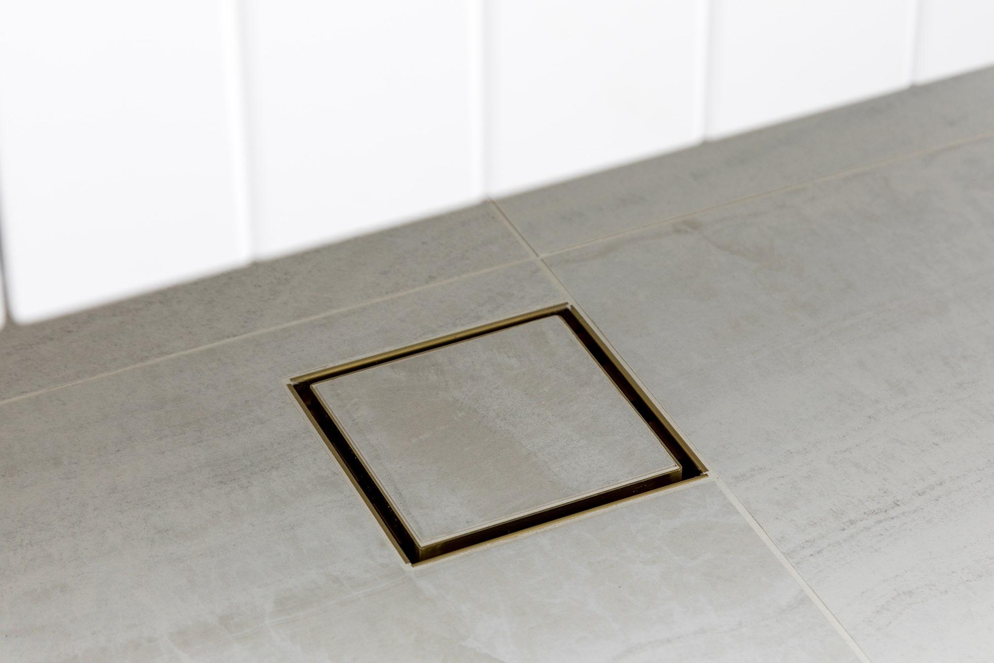 North Beach Coastal Barn Bathroom with tile insert drain.