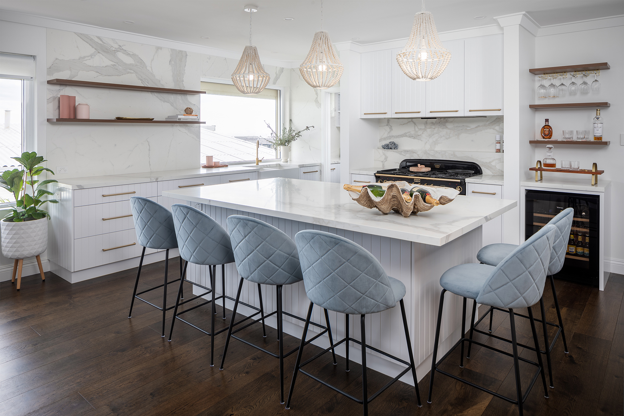 North Beach Coastal Barn Kitchen that is light and bright with dark timber flooring, a feature Falcon oven and white stone look benchtops.