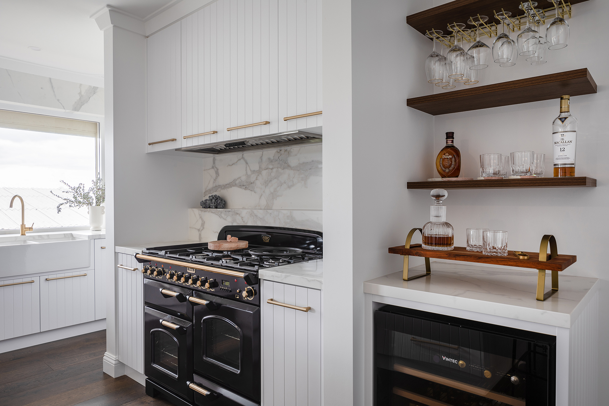 North Beach Coastal Barn Kitchen close up of feature Falcon oven in black with porcelain stone tile splashback and V groove cabinetry below and above.