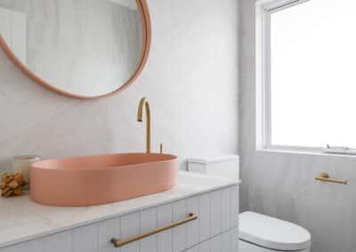 North Beach Coastal Barn Powder Room- vanity, mirror, basin and tiolet
