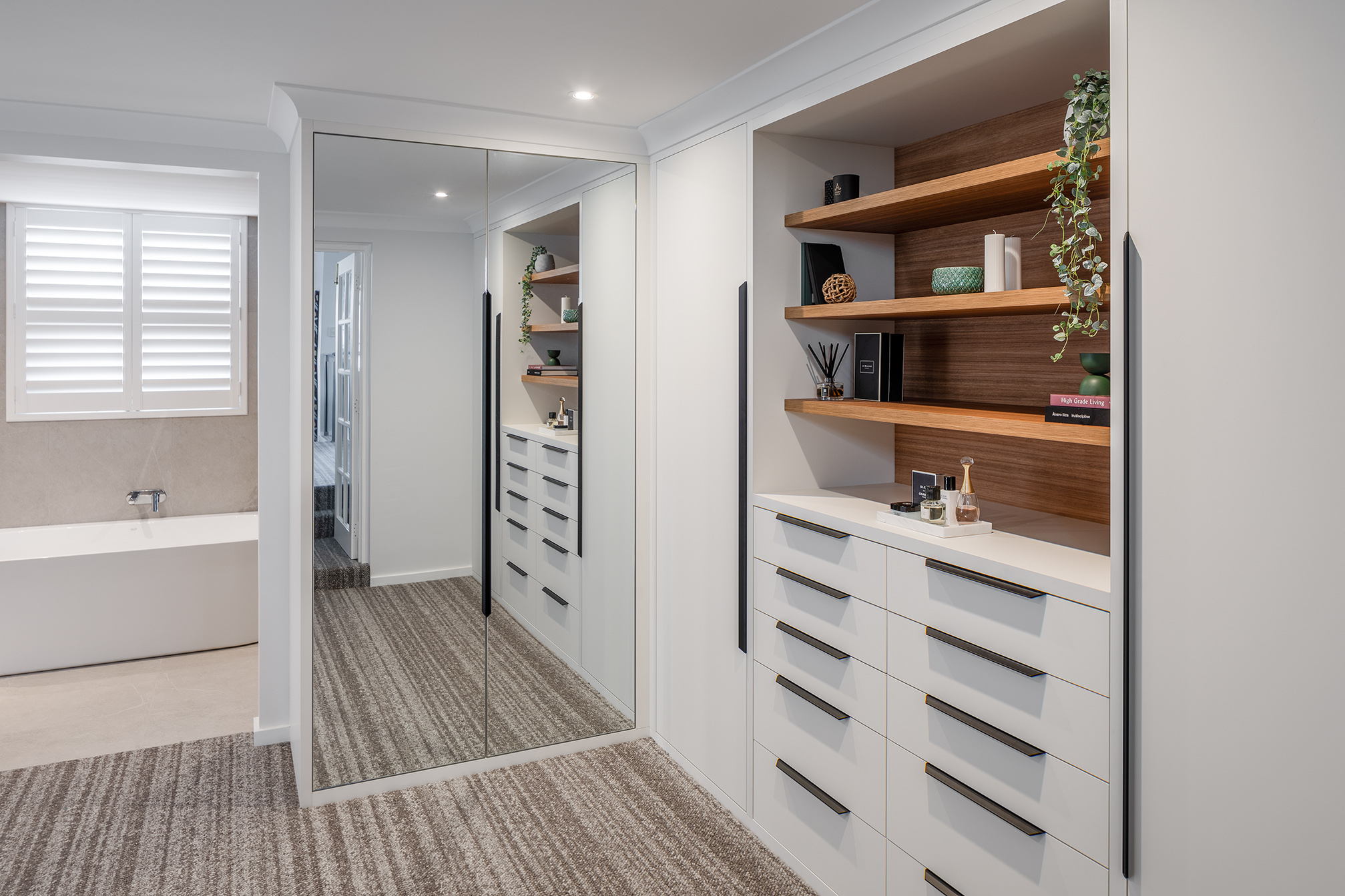 Scarborough Ensuite bedroom with custom cabinetry to surround bed head