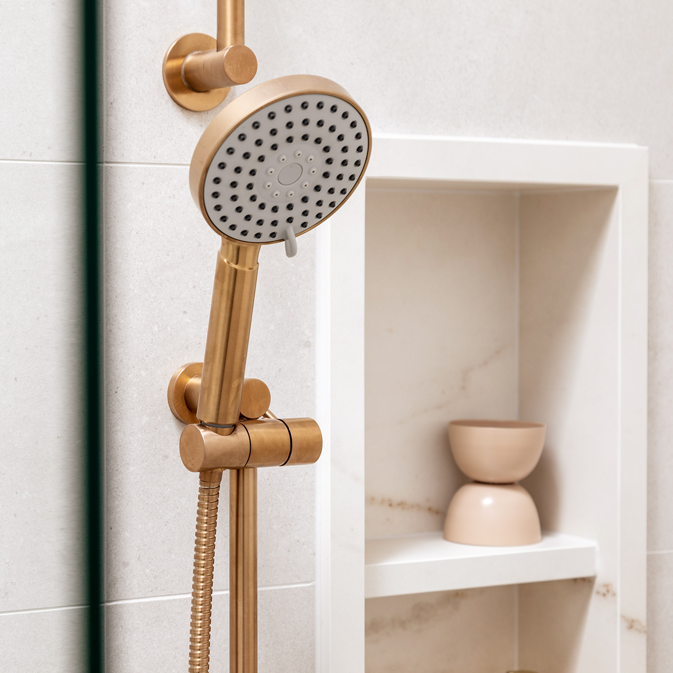 Mount Lawley Traditional Skylit Ensuite - Close up of shower niche in stone look tile and brass shower head