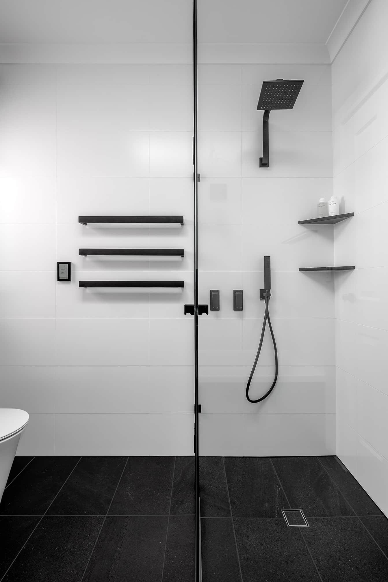 Monochrome Main Bathroom toilet and shower