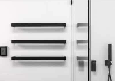 Monochrome Main Bathroom heated towel rails with timer