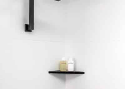 Monochrome Main Bathroom shower shelves