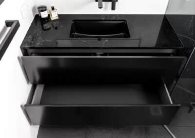 Monochrome Ensuite black vanity with black stone benchtop