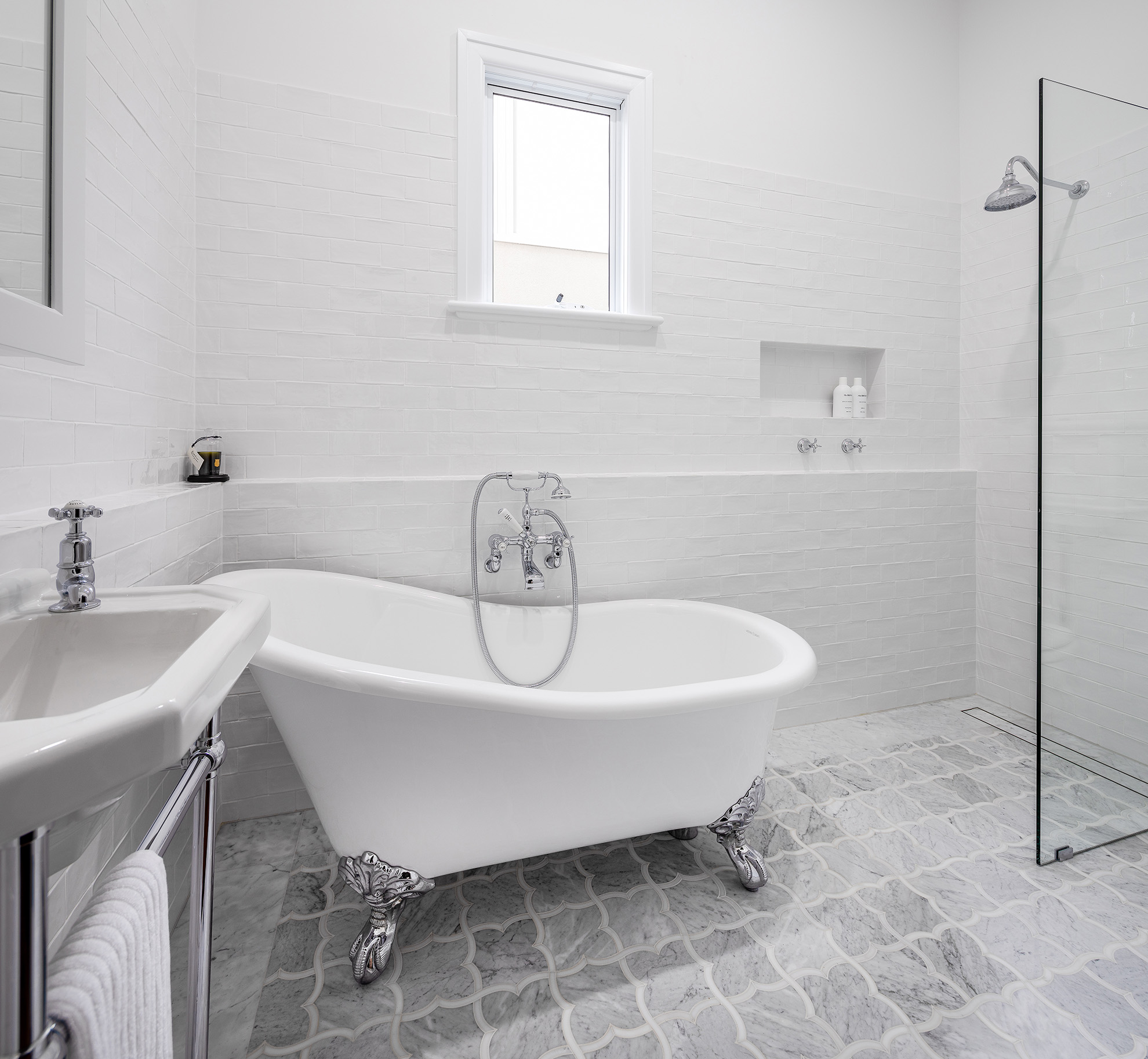 Monochrome Ensuite overview with black vanity, feature stone look panels, plenty of light