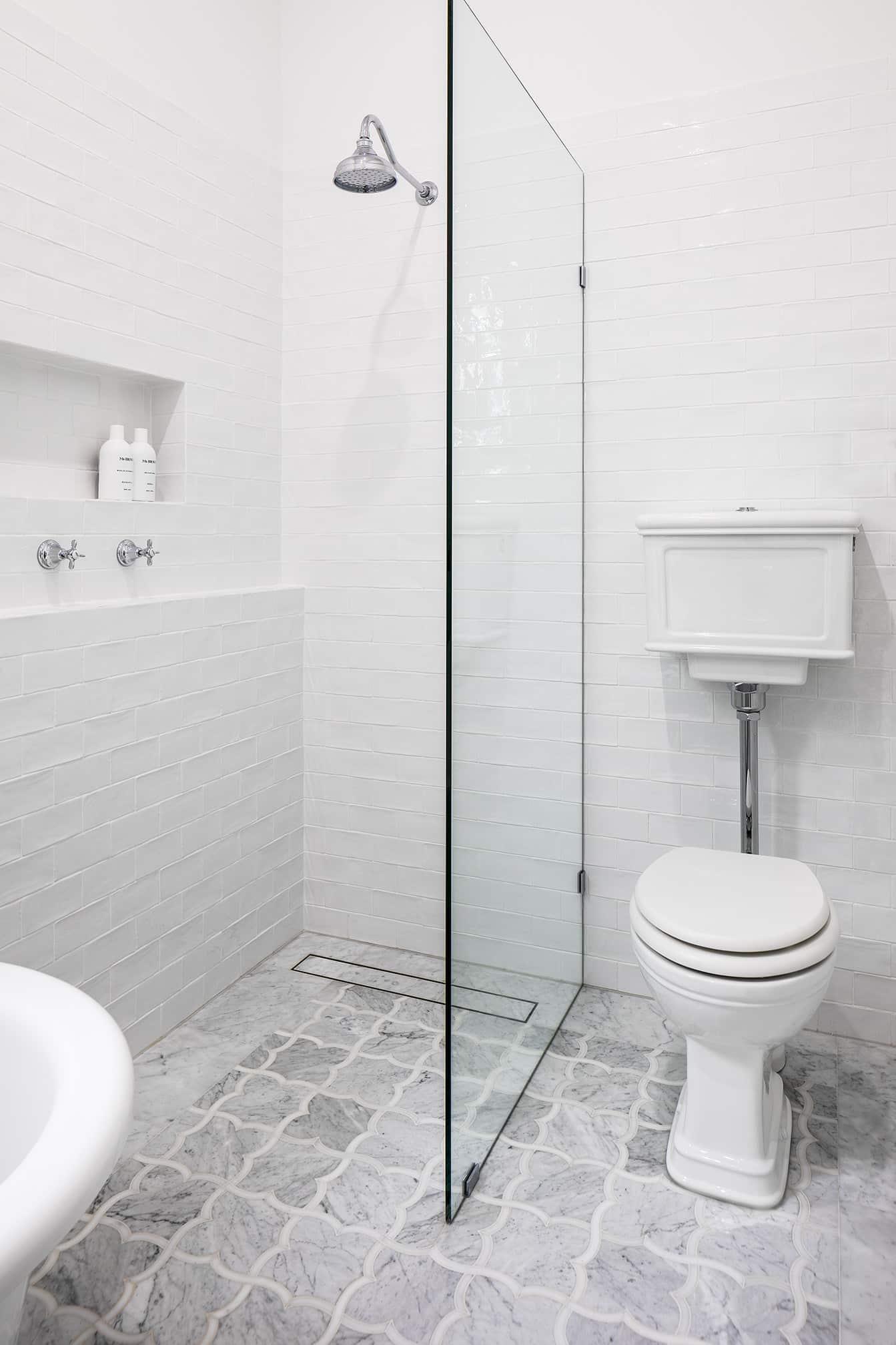 Monochrome Ensuite black stone look feature panel in shower niche